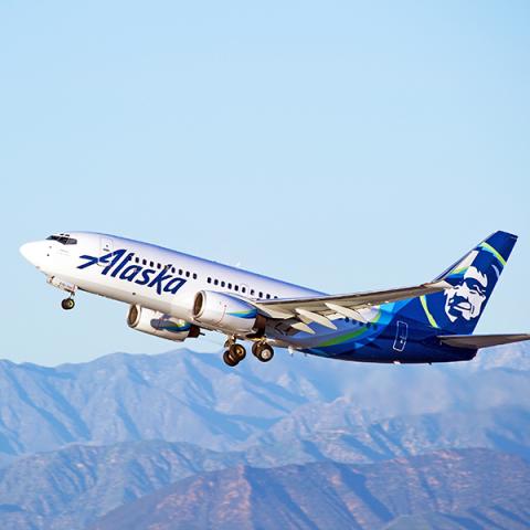 Alaska airline plane in mid takeoff